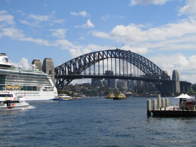 Sydney Ferries Under the Harbour Bridge - Dwarfed by a Liner