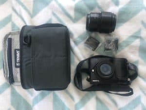Panasonic GX85 Camera with 45-150 lens plus 2 separate batteries. The case is a Tenba 7 BYO insert
